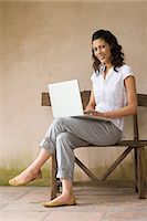 people sitting on bench - Woman on bench using laptop Stock Photo - Premium Royalty-Freenull, Code: 6114-06611747