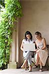 Young women looking at laptop Stock Photo - Premium Royalty-Free, Artist: David & Micha Sheldon, Code: 6114-06611748