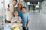 Family using a camera phone in an airport Stock Photo - Premium Royalty-Free, Artist: CulturaRM, Code: 6114-06611821