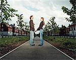 Couple holding hands in an avenue Stock Photo - Premium Royalty-Free, Artist: Frank Rossbach, Code: 6114-06611837
