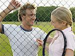Young couple flirting at tennis court Stock Photo - Premium Royalty-Free, Artist: Aflo Sport, Code: 6114-06611873