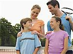 Family on tennis court Stock Photo - Premium Royalty-Free, Artist: Blend Images, Code: 6114-06611875