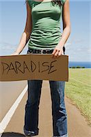 person holding sign - Woman hitchhiking Stock Photo - Premium Royalty-Freenull, Code: 6114-06611932