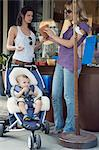Women shopping with baby Stock Photo - Premium Royalty-Freenull, Code: 6114-06611994