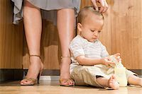 Baby at mother's feet Stock Photo - Premium Royalty-Freenull, Code: 6114-06611995