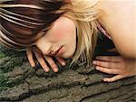 Woman sleeping on a log Stock Photo - Premium Royalty-Free, Artist: ableimages, Code: 6114-06612049