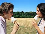 Man and woman eating ice creams Stock Photo - Premium Royalty-Free, Artist: photo division, Code: 6114-06612050