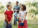 Family having fun in an orchard Stock Photo - Premium Royalty-Free, Artist: Andrew Kolb, Code: 6114-06612062
