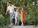 Children and father walking on a log Stock Photo - Premium Royalty-Free, Artist: Robert Harding Images, Code: 6114-06612065