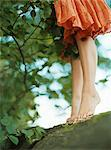 Girl standing barefoot on a log Stock Photo - Premium Royalty-Free, Artist: ableimages, Code: 6114-06612076