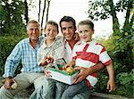 Family eating apples Stock Photo - Premium Royalty-Free, Artist: Blend Images, Code: 6114-06612087