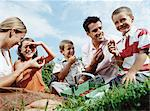 Family eating strawberries Stock Photo - Premium Royalty-Free, Artist: CulturaRM, Code: 6114-06612103