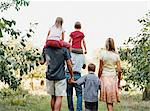 Family walking through an orchard Stock Photo - Premium Royalty-Free, Artist: Kablonk! RM, Code: 6114-06612115