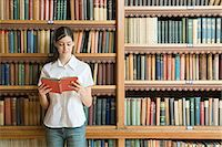 Girl reading in the library Stock Photo - Premium Royalty-Freenull, Code: 6114-06612122