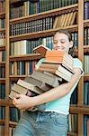 Girl carrying a stack of books Stock Photo - Premium Royalty-Free, Artist: ableimages, Code: 6114-06612130