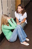 sad girls - Upset girl being comforted by friend Stock Photo - Premium Royalty-Freenull, Code: 6114-06612186