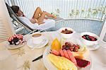 Woman on balcony with breakfast Stock Photo - Premium Royalty-Free, Artist: Cultura RM, Code: 6114-06612281