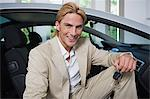 Man sitting in a sports car Stock Photo - Premium Royalty-Free, Artist: Transtock, Code: 6114-06612324