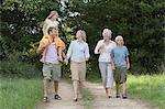 Family walking on a dirt track Stock Photo - Premium Royalty-Free, Artist: Michael Mahovlich, Code: 6114-06612540