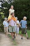 Family walking on a dirt track Stock Photo - Premium Royalty-Free, Artist: CulturaRM, Code: 6114-06612561
