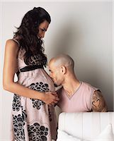 Man kissing pregnant womans belly Stock Photo - Premium Royalty-Freenull, Code: 6114-06612677