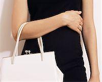 Woman with white handbag Stock Photo - Premium Royalty-Freenull, Code: 6114-06612681