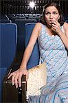Woman spilling popcorn Stock Photo - Premium Royalty-Free, Artist: GreatStock, Code: 6114-06612733