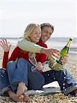Couple on the beach with champagne Stock Photo - Premium Royalty-Free, Artist: Water Rights, Code: 6114-06612764