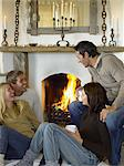Friends by the fire Stock Photo - Premium Royalty-Free, Artist: Blend Images, Code: 6114-06612767