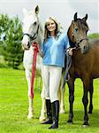Young woman with two horses Stock Photo - Premium Royalty-Free, Artist: Kathleen Finlay, Code: 6114-06612837
