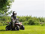 Boy on quad bike Stock Photo - Premium Royalty-Free, Artist: CulturaRM, Code: 6114-06612846