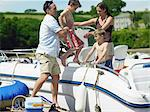Family boarding motorboat Stock Photo - Premium Royalty-Free, Artist: CulturaRM, Code: 6114-06612848