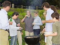 Group of people around barbecue Stock Photo - Premium Royalty-Freenull, Code: 6114-06612854