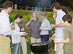 Group of people around barbecue Stock Photo - Premium Royalty-Free, Artist: Cultura RM, Code: 6114-06612854