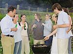Group of people around barbecue Stock Photo - Premium Royalty-Free, Artist: Aflo Relax, Code: 6114-06612865