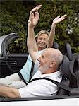 Carefree couple in a convertible Stock Photo - Premium Royalty-Free, Artist: ableimages, Code: 6114-06612874