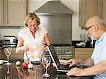 Mature couple in their kitchen Stock Photo - Premium Royalty-Free, Artist: Cultura RM, Code: 6114-06612880