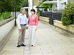 Couple holding hands in a suburban street Stock Photo - Premium Royalty-Free, Artist: Nico Tondini, Code: 6114-06612882