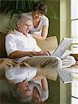Mature couple using laptop computer Stock Photo - Premium Royalty-Free, Artist: Blend Images, Code: 6114-06612883