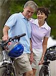 Mature couple with bicycles Stock Photo - Premium Royalty-Free, Artist: CulturaRM, Code: 6114-06612884