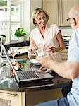 Mature couple in their kitchen Stock Photo - Premium Royalty-Free, Artist: photo division, Code: 6114-06612916