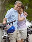 Mature couple with bicycles Stock Photo - Premium Royalty-Free, Artist: Cusp and Flirt, Code: 6114-06612919