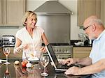Mature couple in their kitchen Stock Photo - Premium Royalty-Free, Artist: Photocuisine, Code: 6114-06612930