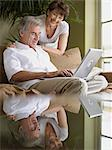 Mature couple using laptop computer Stock Photo - Premium Royalty-Free, Artist: Blend Images, Code: 6114-06612934