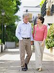 Mature couple walking hand in hand Stock Photo - Premium Royalty-Free, Artist: Kablonk! RM, Code: 6114-06612948