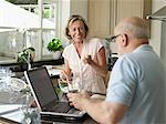 Mature couple in their kitchen Stock Photo - Premium Royalty-Free, Artist: Jean-Christophe Riou, Code: 6114-06612955