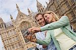 Couple taking photo of Houses of Parliament Stock Photo - Premium Royalty-Free, Artist: ableimages, Code: 6114-06613053
