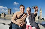 Couple taking photograph by Houses of Parliament Stock Photo - Premium Royalty-Free, Artist: ableimages, Code: 6114-06613102
