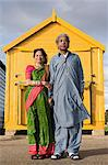 Indian couple outside beach hut Stock Photo - Premium Royalty-Free, Artist: Blend Images, Code: 6114-06613191