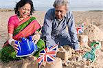 Couple making sandcastles Stock Photo - Premium Royalty-Free, Artist: Blend Images, Code: 6114-06613194